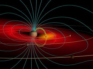 Rendition of Jupiter's magnetic field, or magnetosphere. Note how Jupiter's moons are surrounded, but Earth is not. Photo courtesy of Wikipedia user, Volcanopele